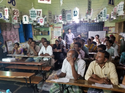 Farmers gathered in a primary school to pass the first economic experiment
