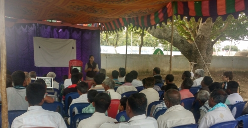 Deepti U., PhD student at IISc, presenting ATCHA outcomes to farmers in the premises of Puttanapura primary school